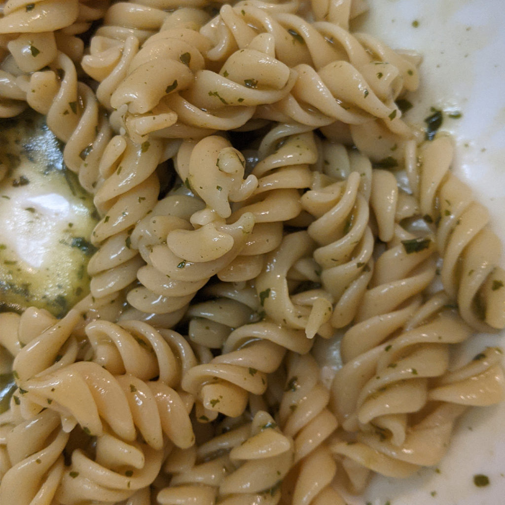 Knorr pesto sauce mixed up and on pasta.